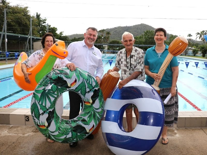 Douglas Shire Mayor Michael Kerr with Rotary Club of Mossman President Jan Stokes with members John Anich and Evelyn Matthews in preparation for the Aussie Family Pool Party at the Mossman Pool